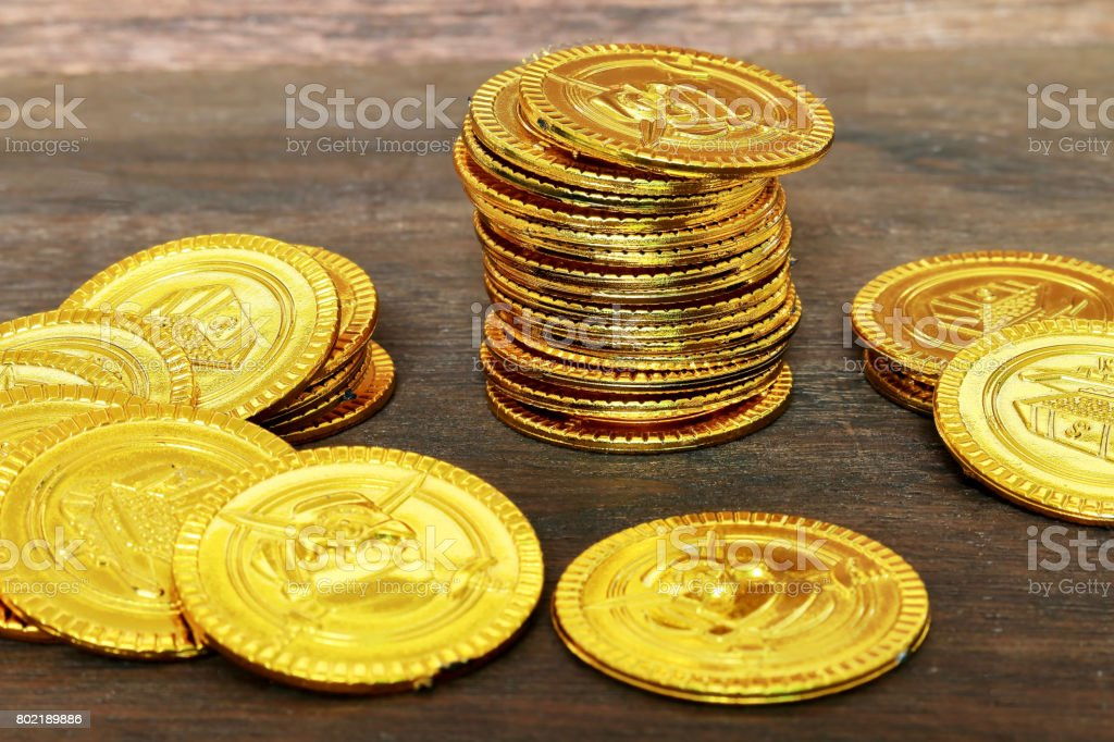 Toy gold coins stock photo