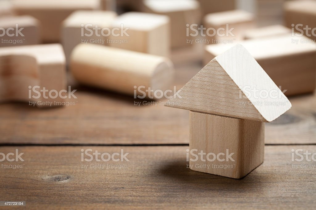 Toy house on old wooden table stock photo