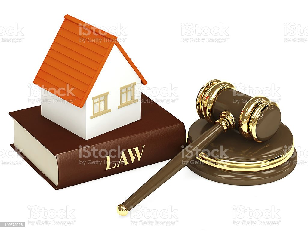 A toy house on top of a law book next to a gavel royalty-free stock photo