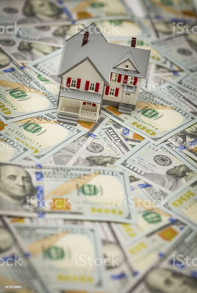 Toy house on top of one hundred dollar bills royalty-free stock photo
