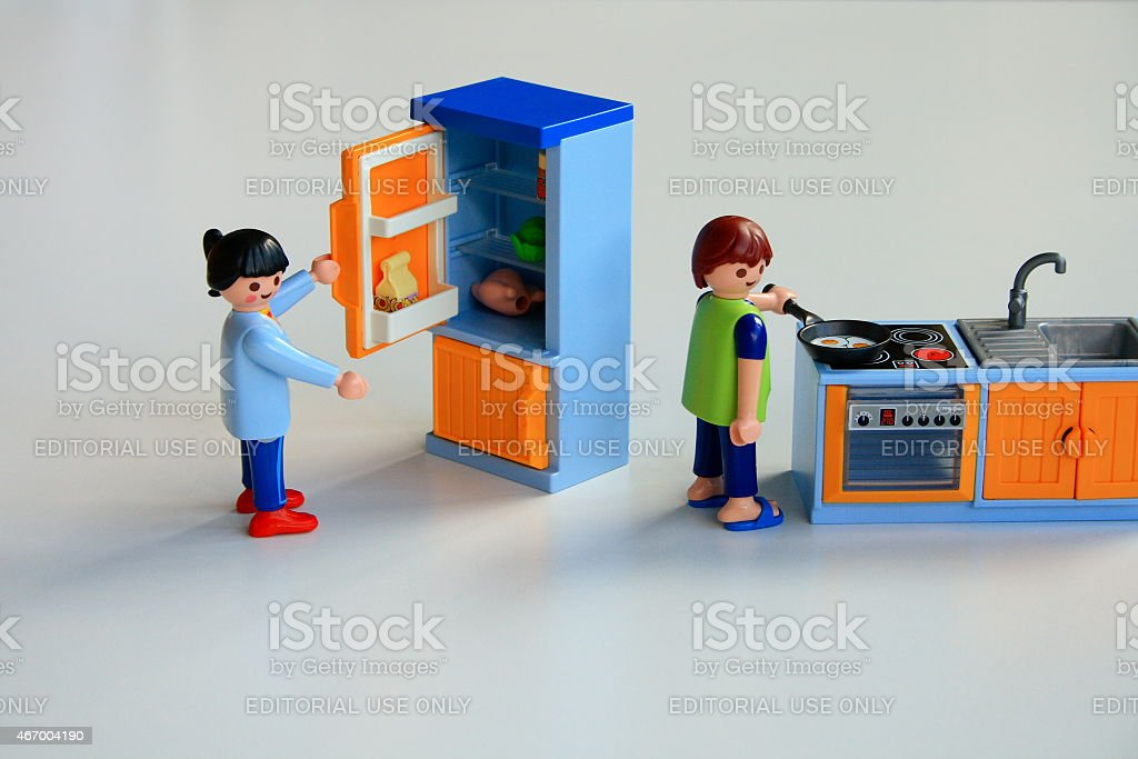 Toy man and a woman staying at home cooking. stock photo