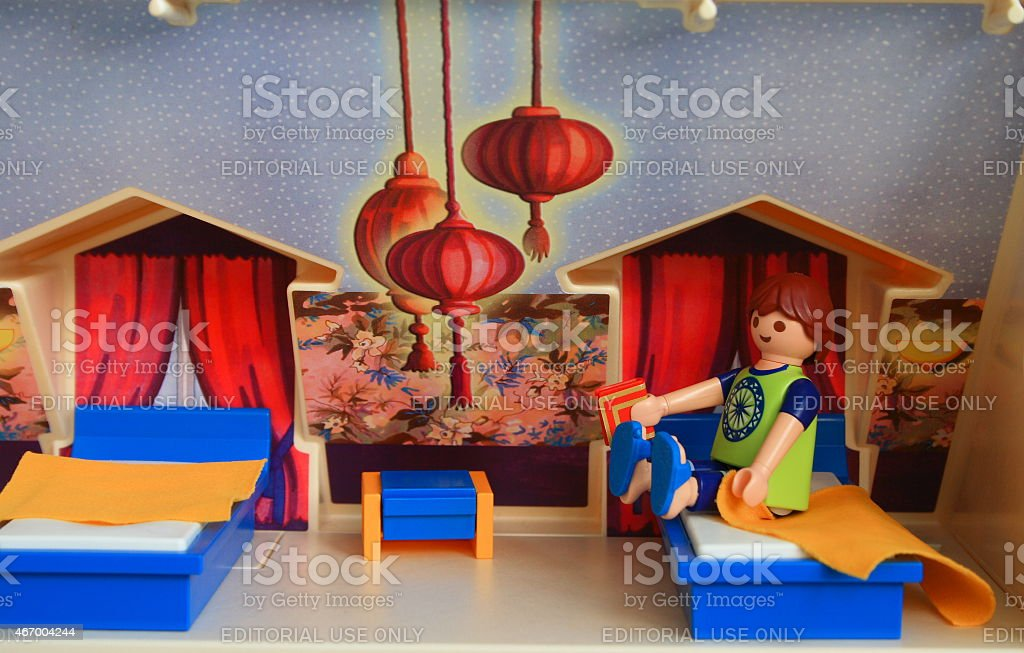 Toy man will just read a book before bed. stock photo