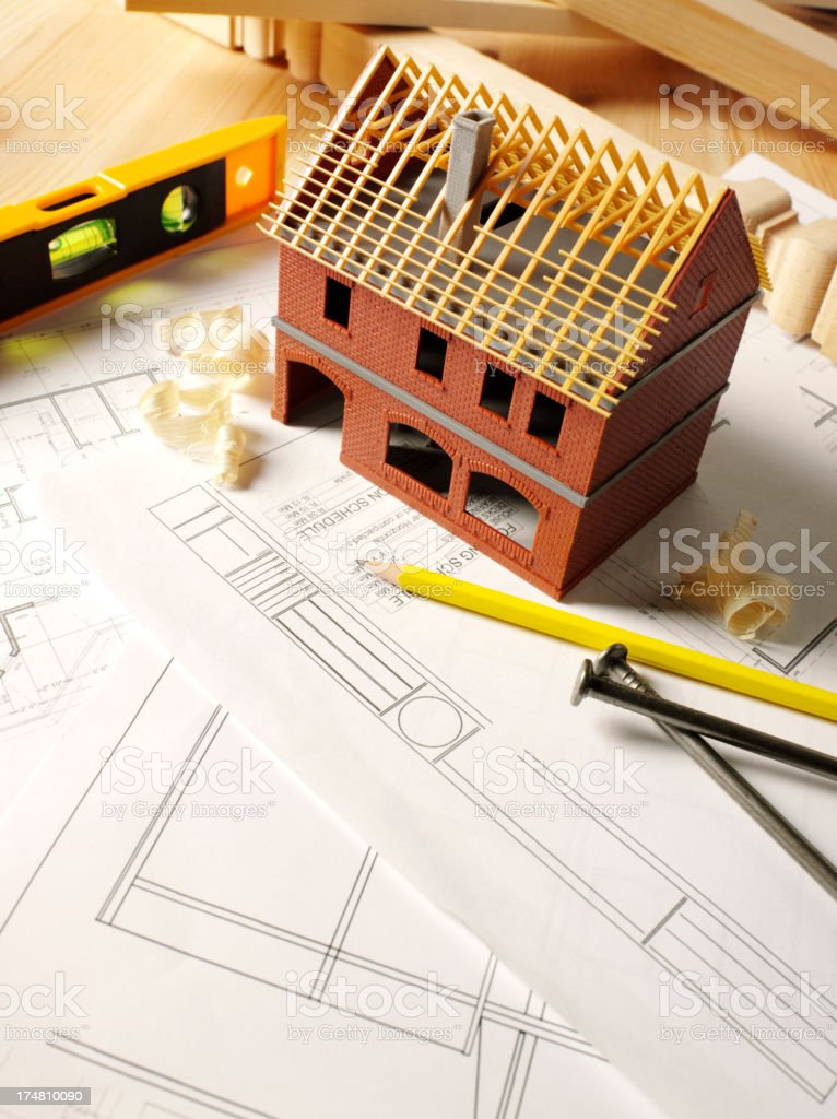 Toy Model House with a Blueprint Plan royalty-free stock photo