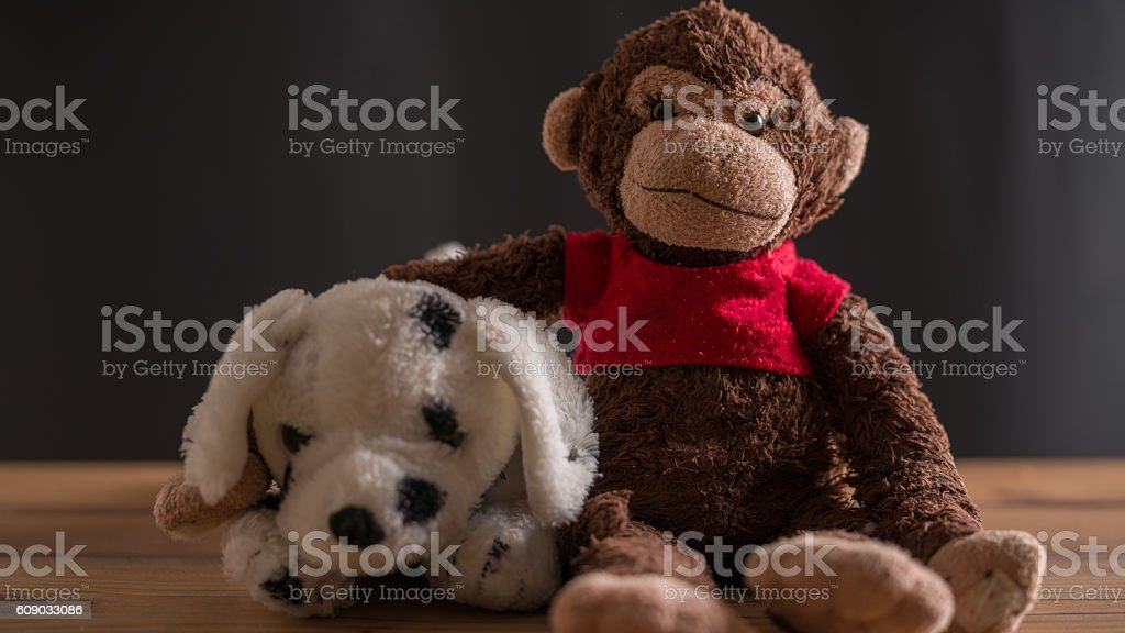 Toy monkey and cow stock photo