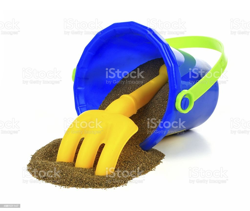 Toy pail with sand stock photo