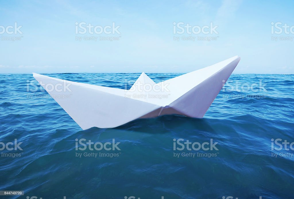 Toy paper ship on the sea stock photo