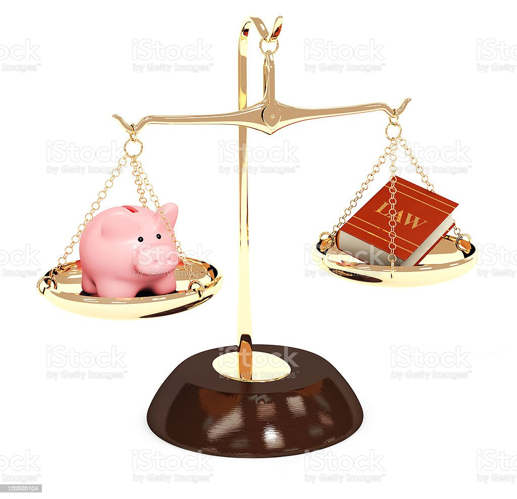 A toy pig and a mini law book balancing on a scale royalty-free stock photo