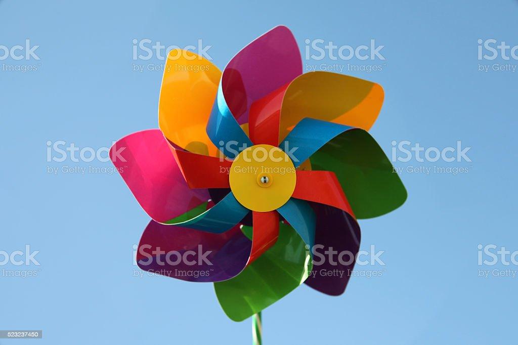 Toy pinwheel with blue sky background stock photo