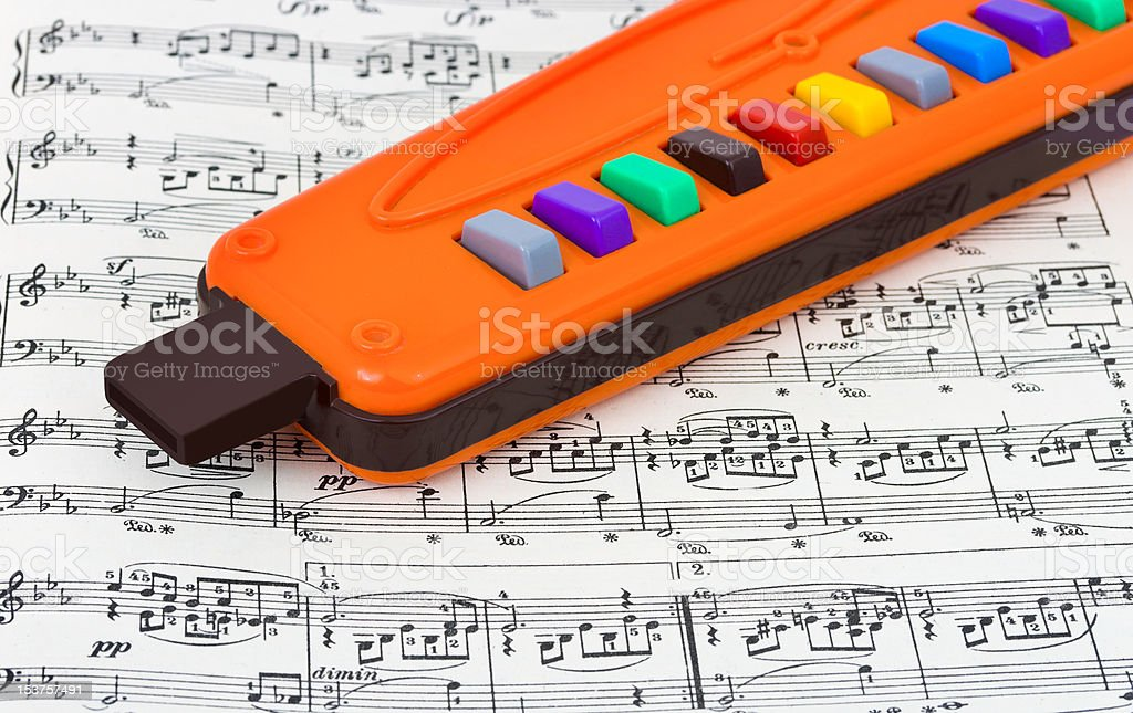Toy pipe and sheet music royalty-free stock photo