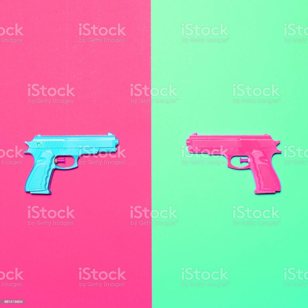Toy pistols on colorful background  - Minimal design top view stock photo