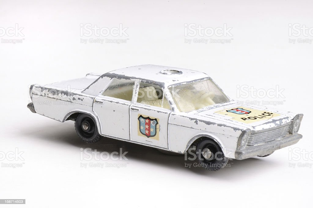 Toy Police car  1960s metal white background royalty-free stock photo
