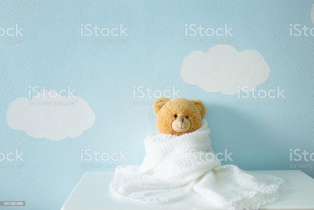 toy portrait in white wool blanket stock photo
