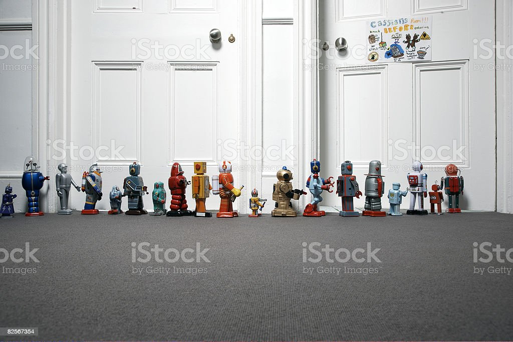 toy robots lined up outside childs bedroom stock photo