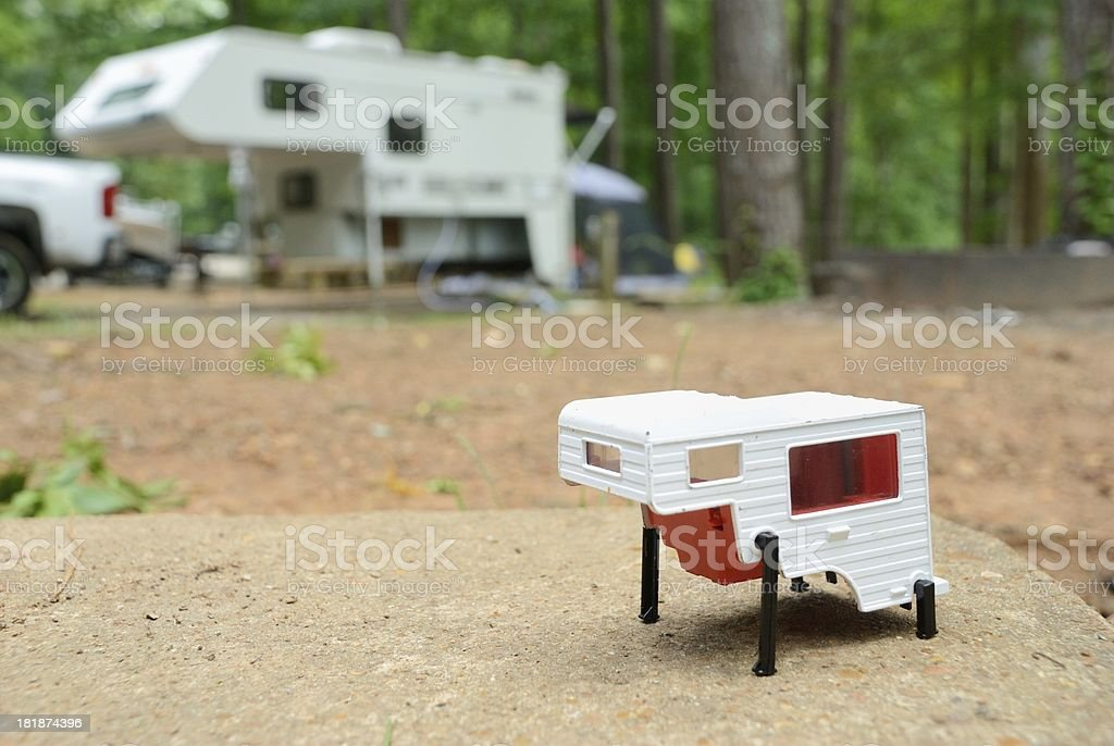 Toy rv camper in campground royalty-free stock photo