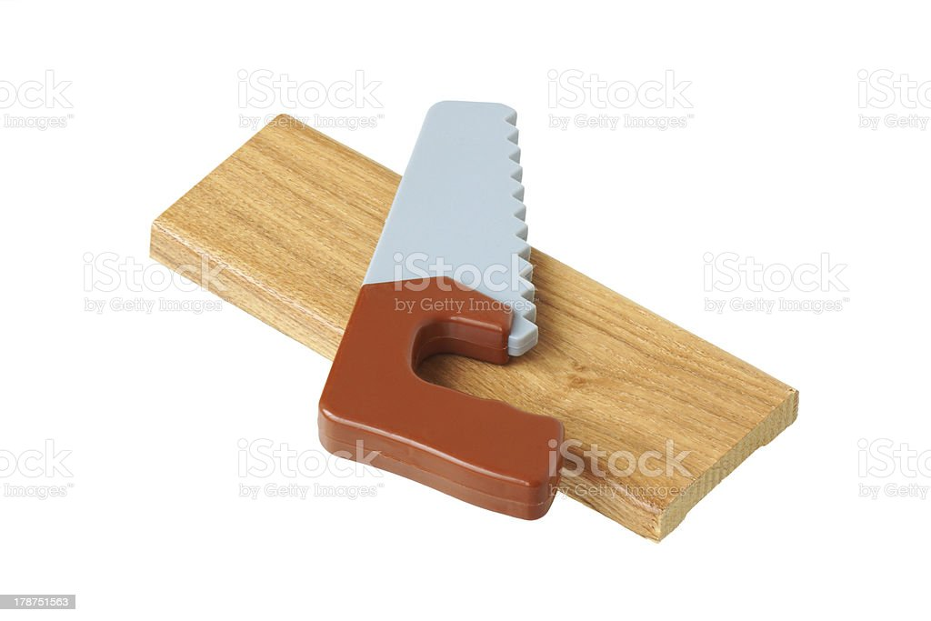 toy saw on a piece of wood royalty-free stock photo