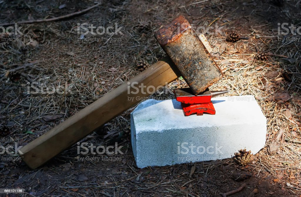 Toy Small Anvil And Huge Rusty Hammer stock photo