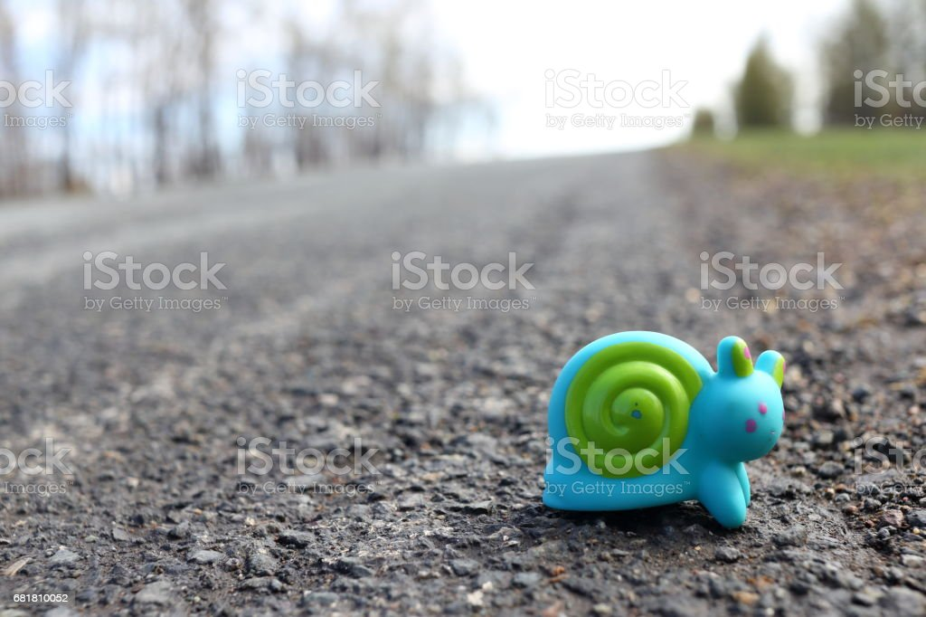 Toy snail on the road stock photo
