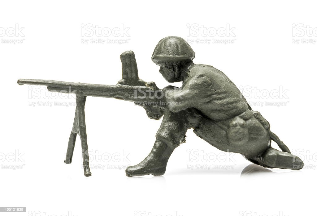 Toy solder crouched and firing gun royalty-free stock photo