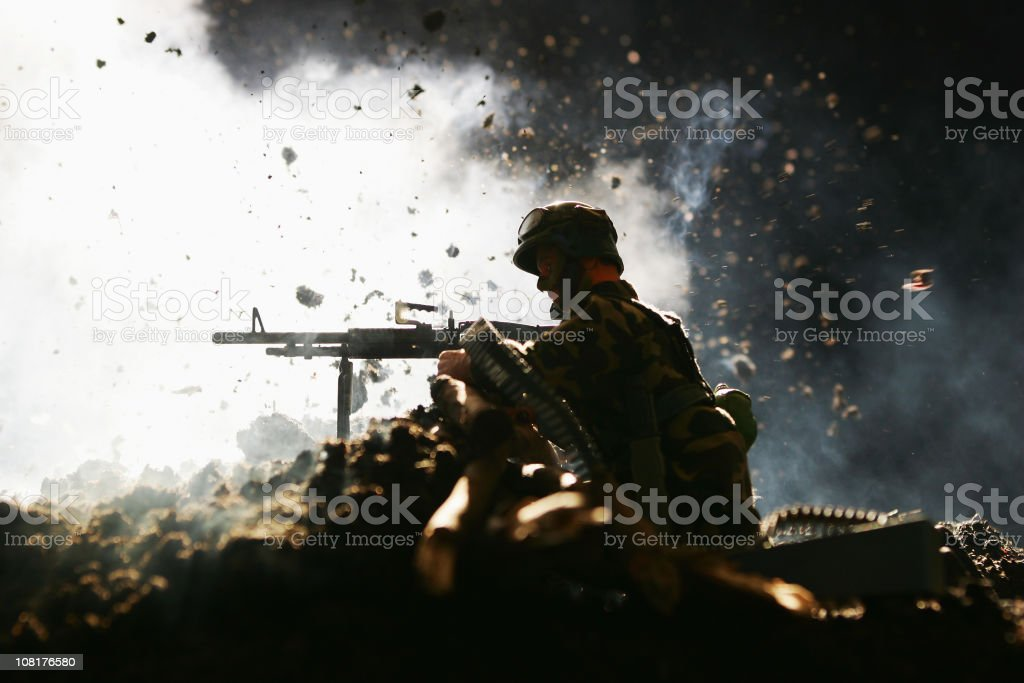 Toy Soldier Gunner in Front of Explosion royalty-free stock photo