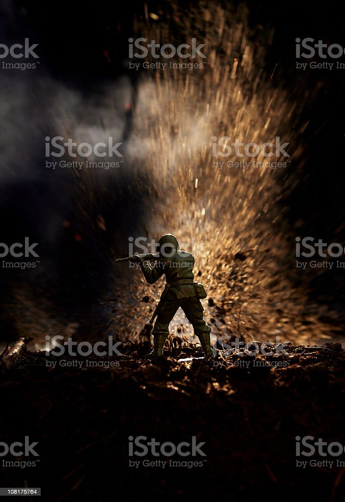 Toy Soldier in  Front of Explosion royalty-free stock photo