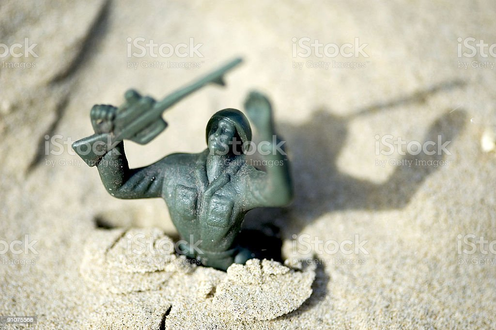 Toy soldier on sand royalty-free stock photo