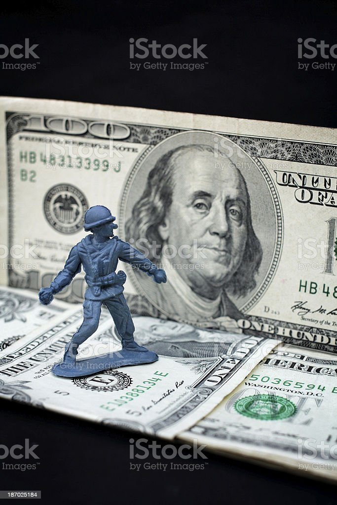 toy soldier standing with dollar royalty-free stock photo
