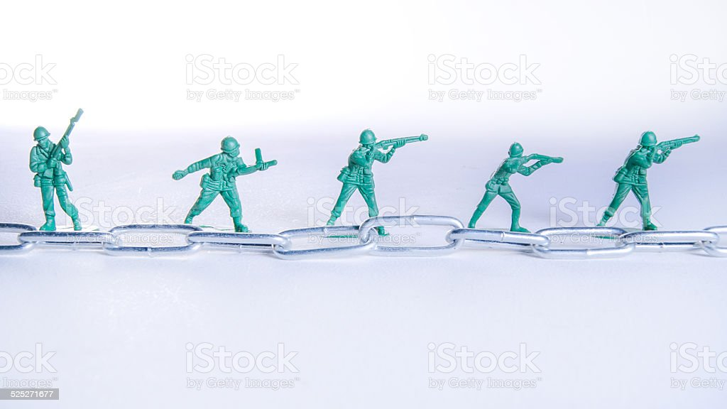 Toy Soldiers in line with Steel Chain stock photo