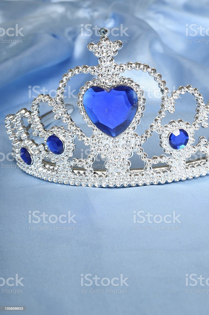 Toy tiara with diamonds and blue gem royalty-free stock photo