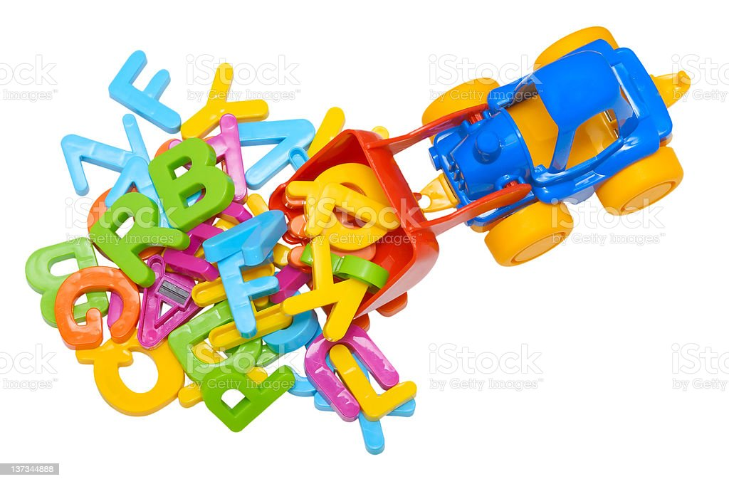 toy tractor and alphabet royalty-free stock photo