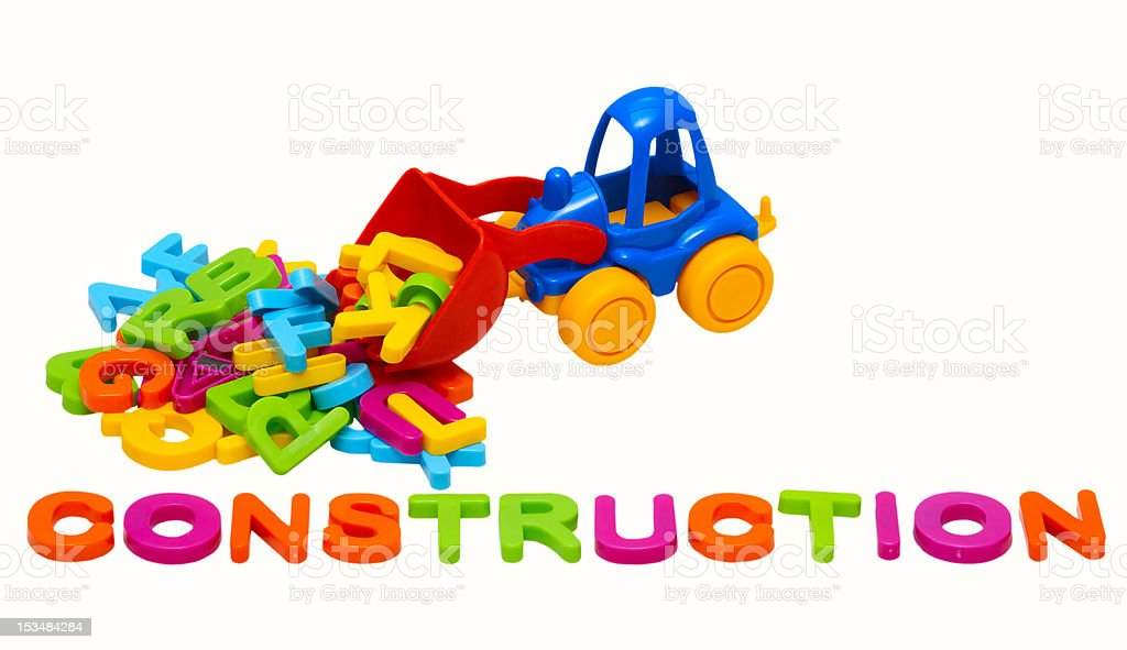 toy tractor and word - construction royalty-free stock photo