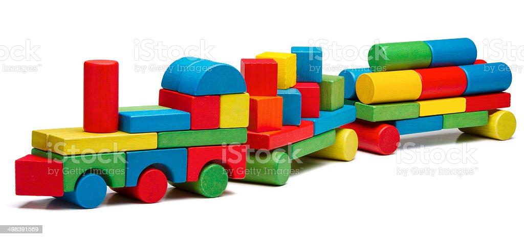 toy train goods van, wooden blocks cargo railway transportation stock photo