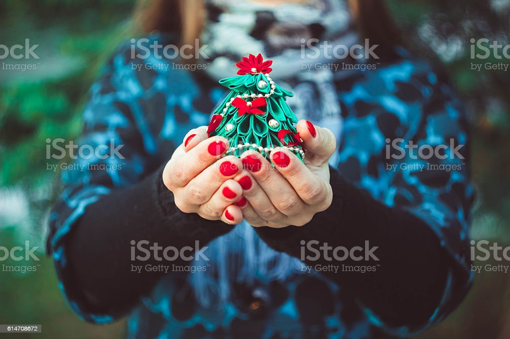 toy tree in hands stock photo