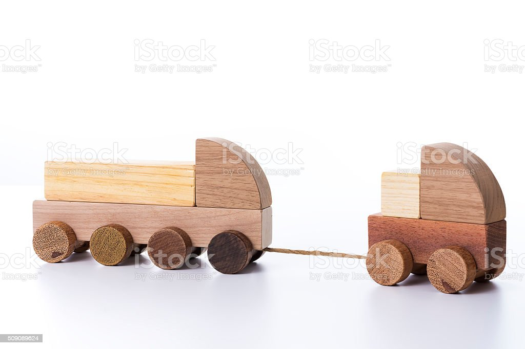 Toy trucks made of wood stock photo
