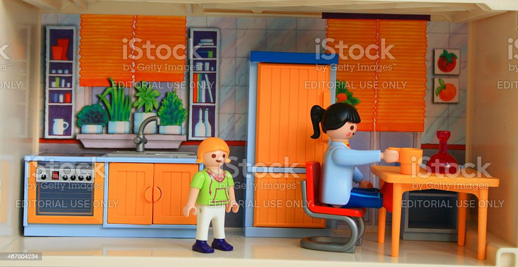 Toy woman and a child staying at home. stock photo