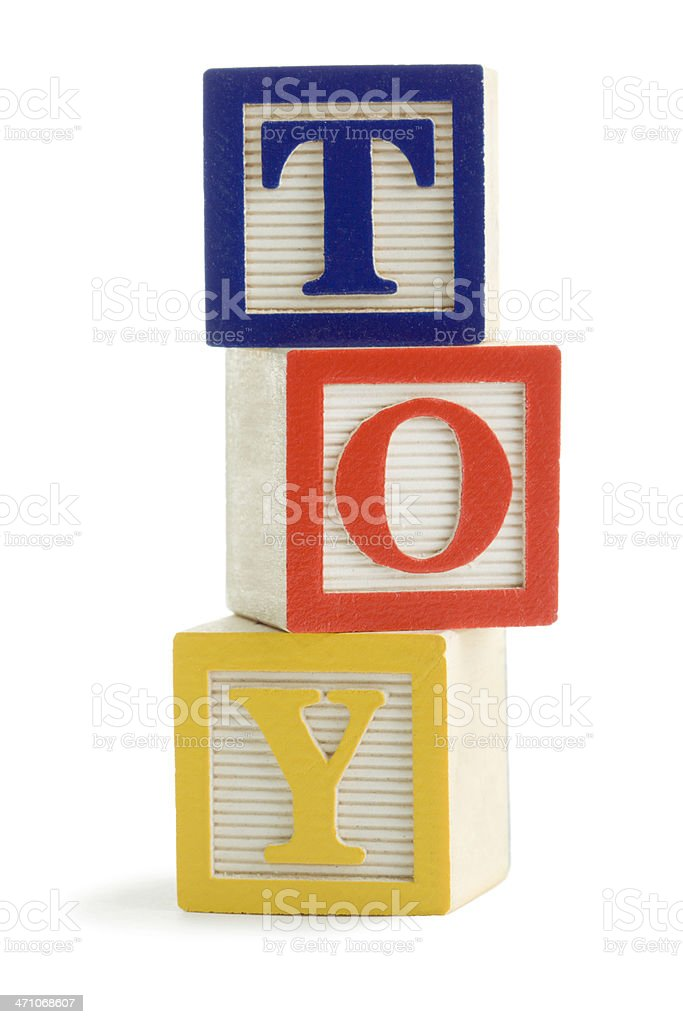 Toy Wooden Block Cubes Stacked for Education, Learning Spelling, Balance royalty-free stock photo