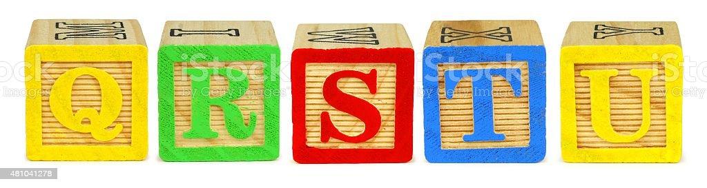 Toy wooden letter blocks Q R S T U stock photo