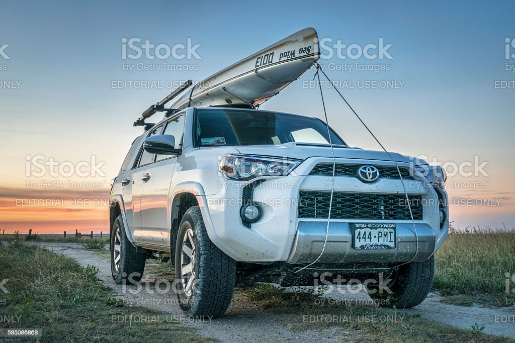 Toyota 4Runner SUV with canoe on roof stock photo
