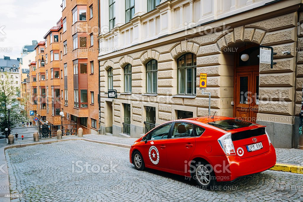 Toyota Prius car parked at sidewalk on Bagares street Stockholm stock photo