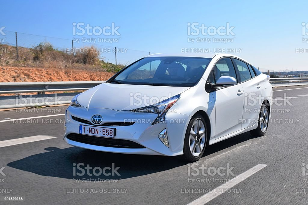 Toyota Prius driving on the highway stock photo