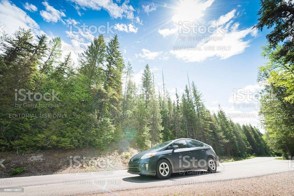 Toyota Prius Hybrid Car on Road Trip Glacier National Park stock photo