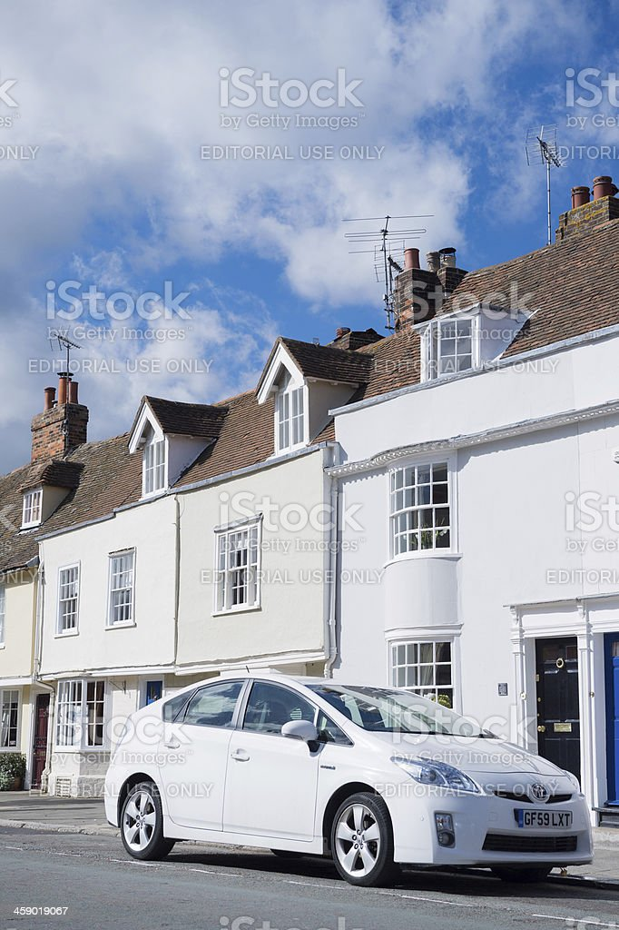 Toyota Prius parked in front of residence royalty-free stock photo