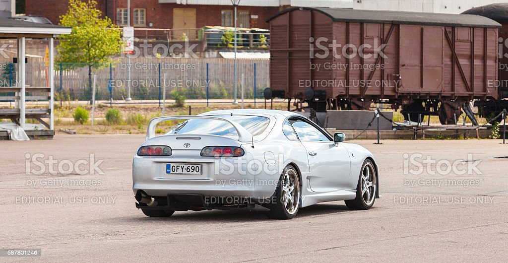 Toyota Supra SZ sport car goes down the street stock photo