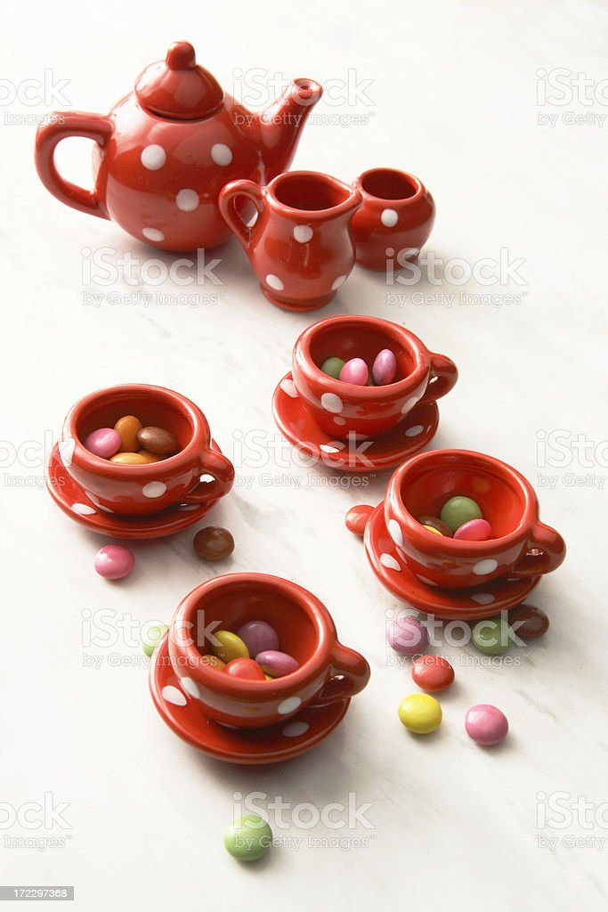 Toys: Children's Tea Set and Candy royalty-free stock photo
