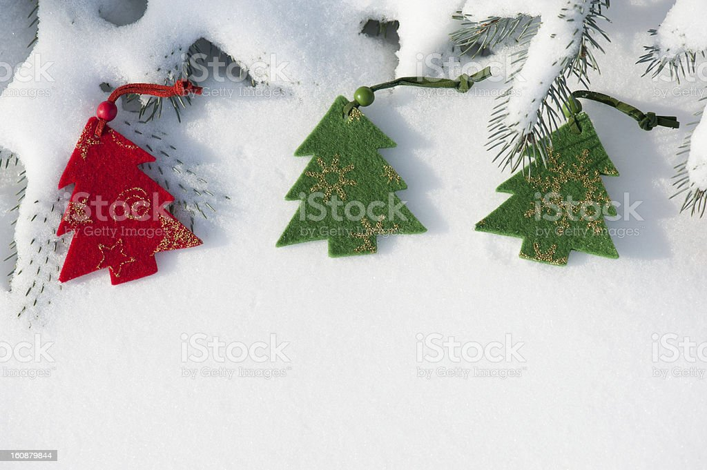 Toys on the christmas tree at snow royalty-free stock photo