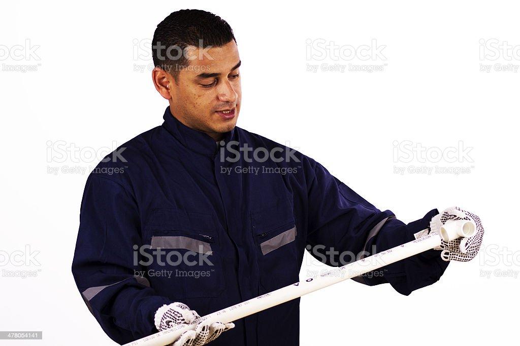 Trabajador uniendo dos piezas de PVC royalty-free stock photo