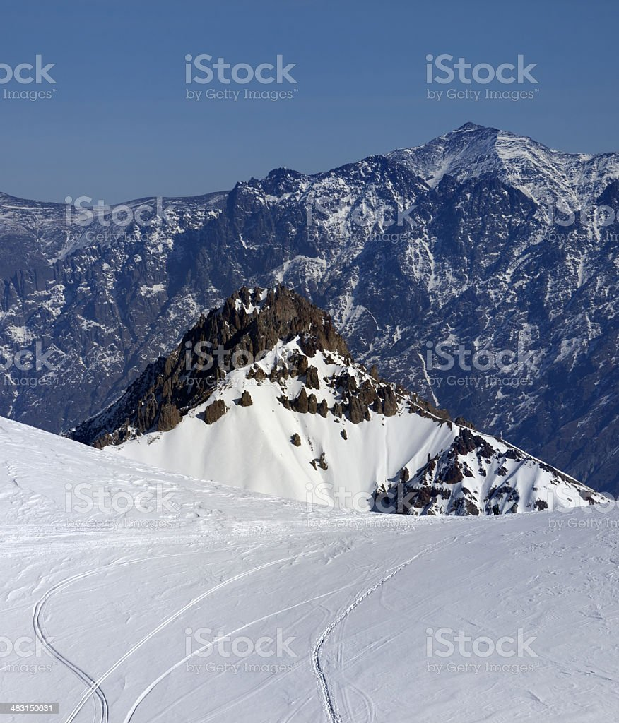 Trace from ski and snowboards on off-piste slope royalty-free stock photo