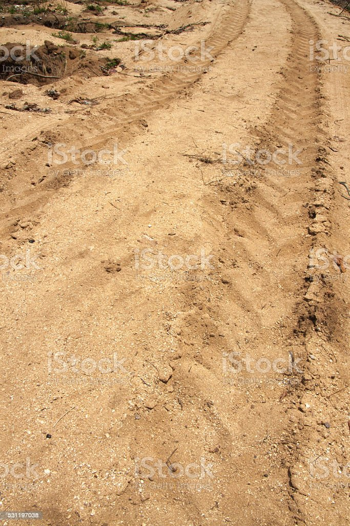 Trace of car wheel on sand ground royalty-free stock photo