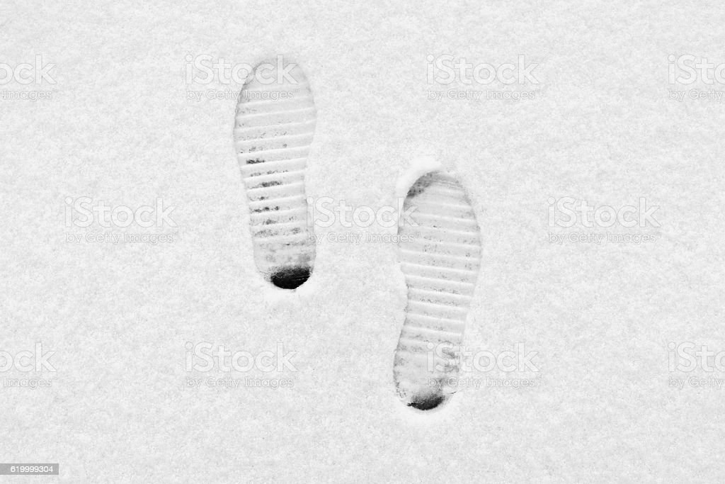 Traces from boots on snow stock photo