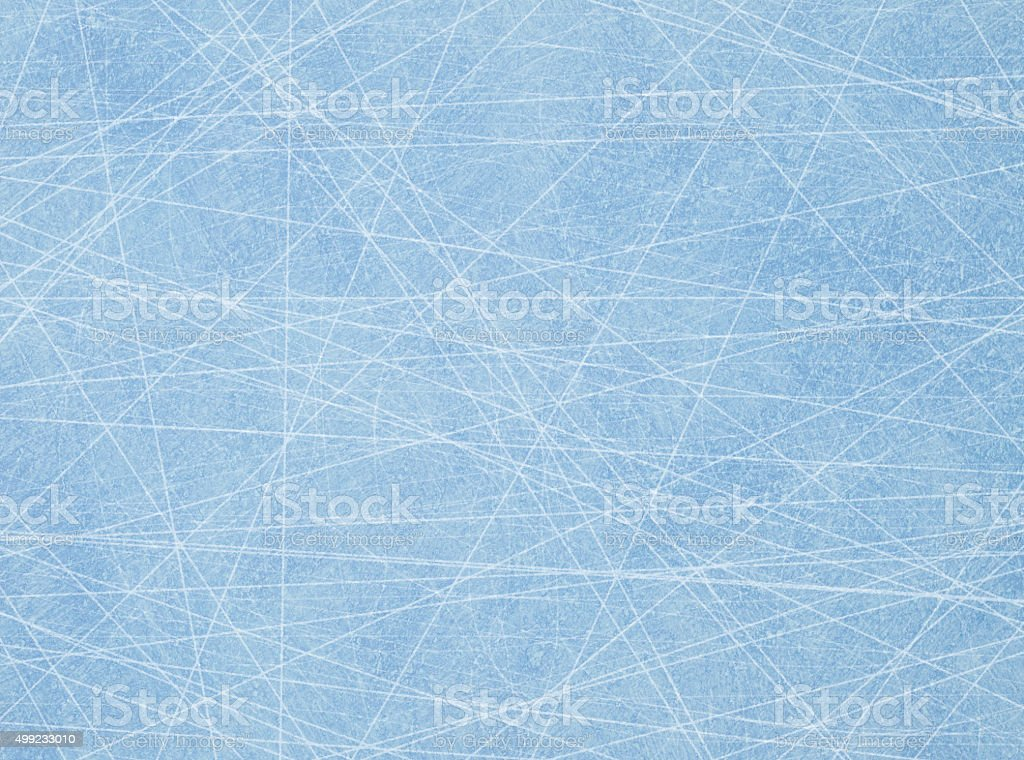 Traces from the skates on blue ice stock photo