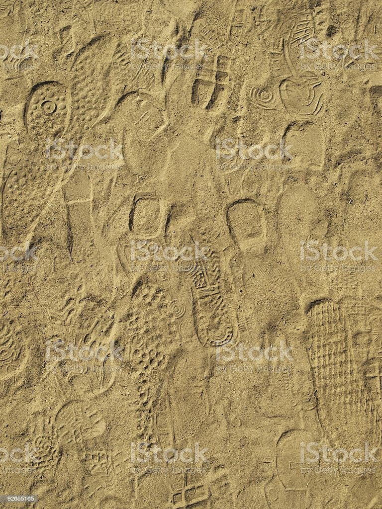 Traces of foots on sand stock photo
